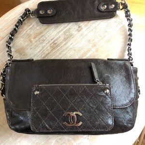 Vintage Chanel brown caviar leather bag .
